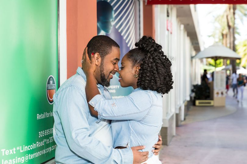 Couple's engagement photo session at Lincoln Road Mall in South Beach Miami Beach