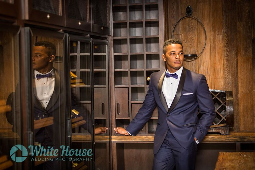 Groom portrait session in the Wine Cellar at The Mayfair Hotel in Coconut Groove Florida
