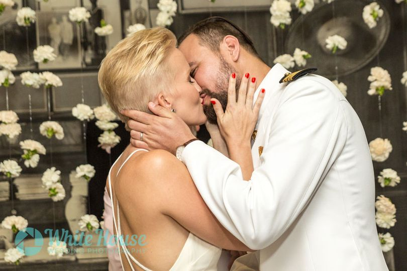 First kiss at wedding ceremony in South Beach Florida