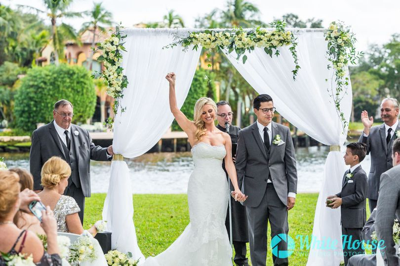 Newlywed Husband and Wife Exiting Cermony in Fort Lauderdale Florida