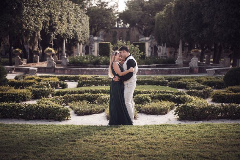 Newlyweds embracing in a park