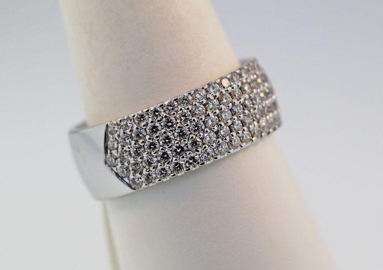 14 karat white gold diamond wedding band/ right hand ring. total diamond weight of 1.10ct diamonds...