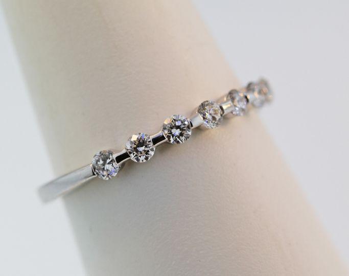 18 karat white gold diamond wedding band. Bar set diamonds going half way around .48 carats total....