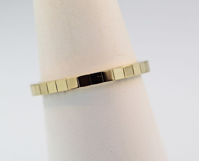 14k yellow gold mirror finish wedding band. 2mm wide size 6. $550.00