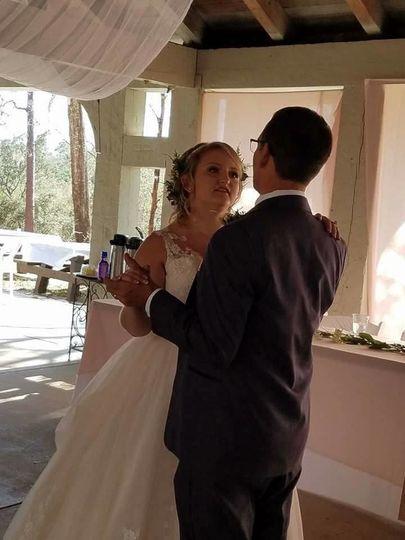 Bride dancing with guest