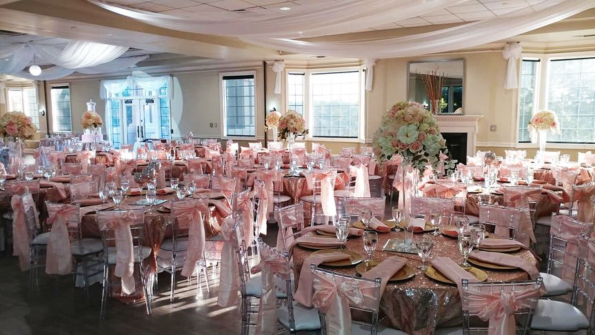 Reception setup in grand ballroom w/ included crystal chiavari chairs