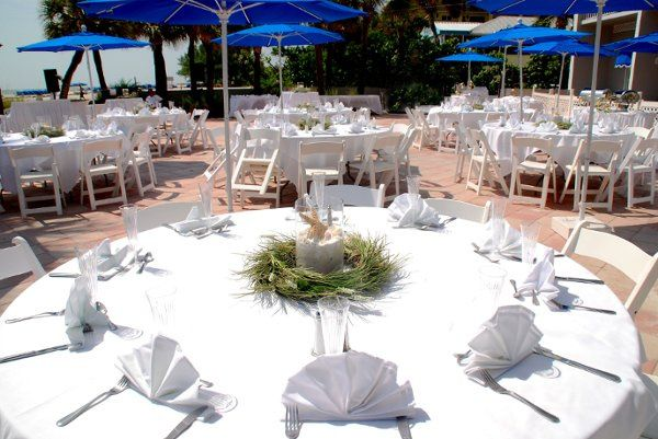 Beachy Wreaths centerpieces of silk sea grasses with glass globe filled with sand, star fish, sand...
