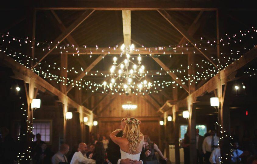 bg dancing in barn with hanign lights