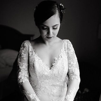 Sleeved lace wedding gown
