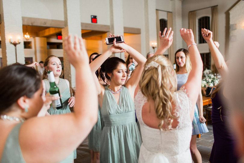 Bride and her bridesmaids on the dance floor