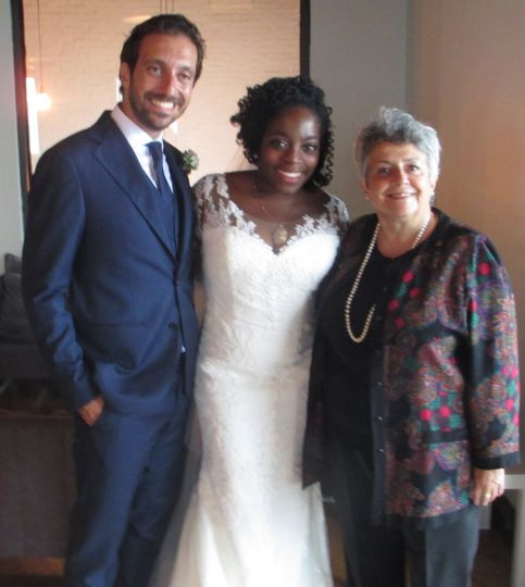 Newlyweds with their officiant