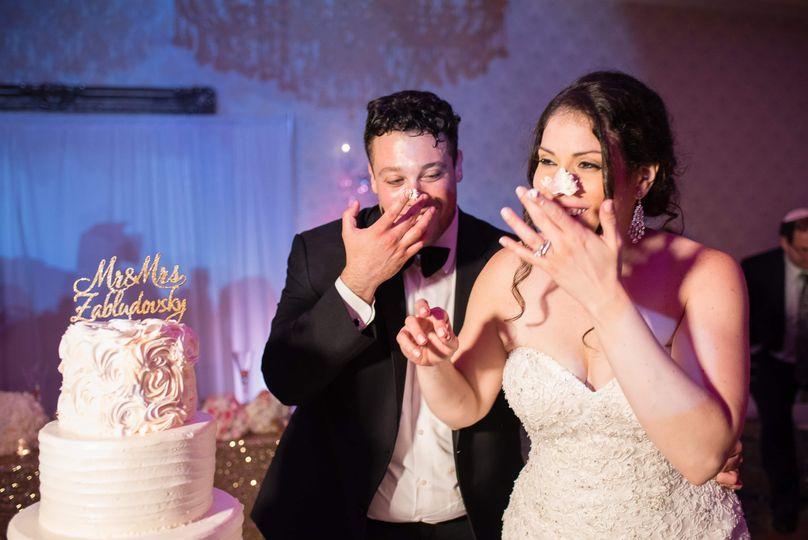 Happy couple cutting cake
