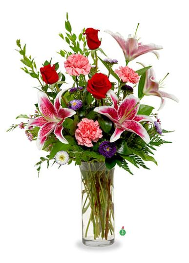 Lily arrangement in glass vase