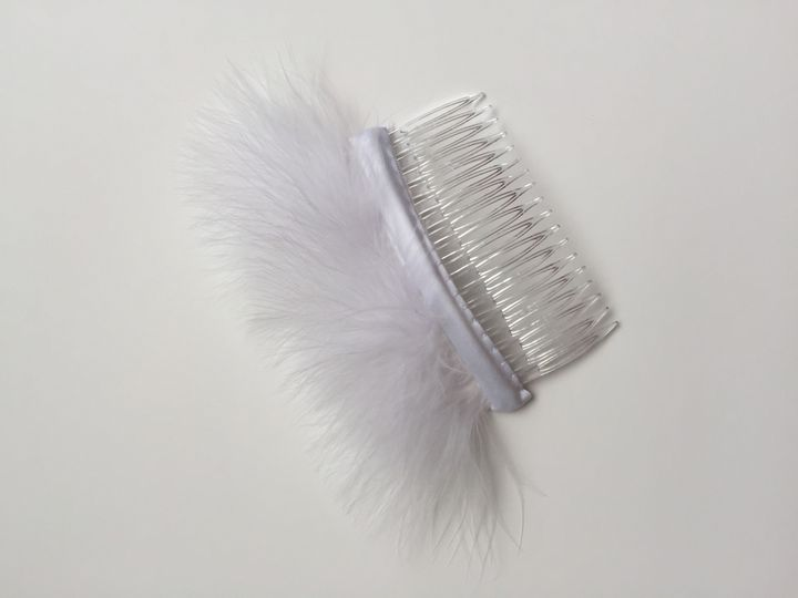 white bridal feathered hair comb