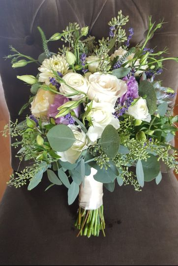 Leafy greens with white and lavender seasonal flowers.