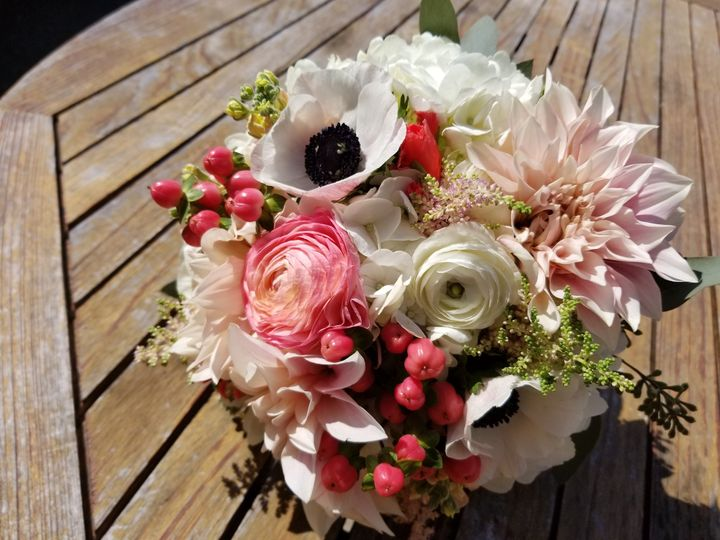 Coral, blush and ivory summer bouquet featuring anemone, ranunculus, dahlia and roses.