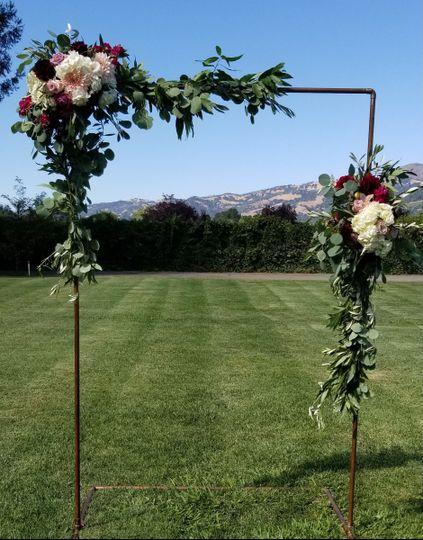 Copper wedding arch floral