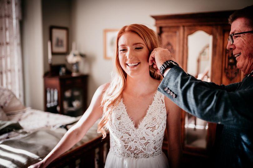 Dad putting in brides earrings