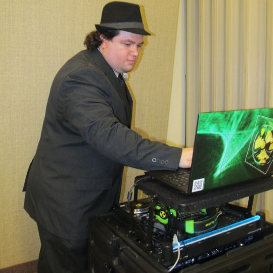 Me, in full suit, with my laptop and mixer.