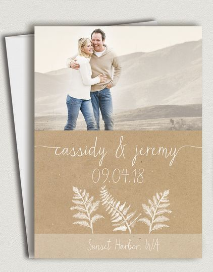 Ferns Wedding photo save the dates featuring rustic botanical ferns and flowing calligraphy fonts....