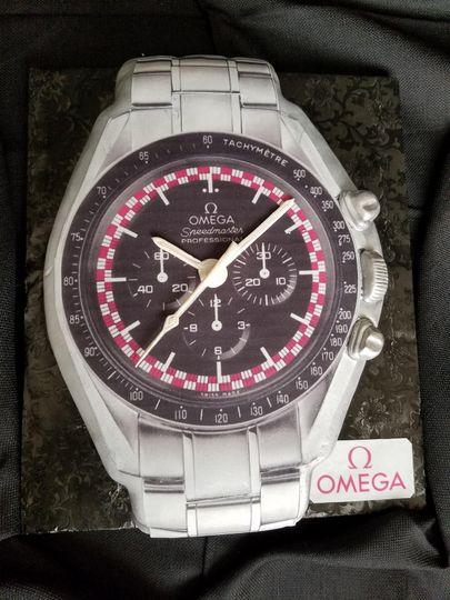 Omega watch bachelor cake.
