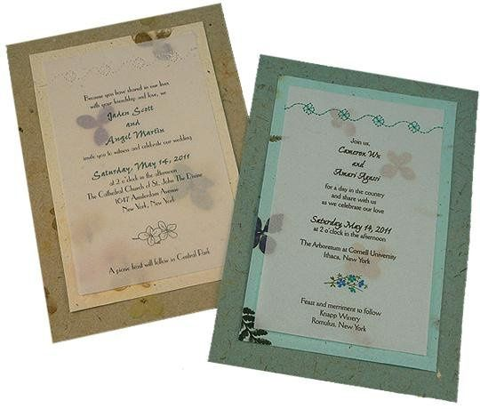 100% recycled handmade double-panel wedding invitations in moss and bluegrass with flower stitching....