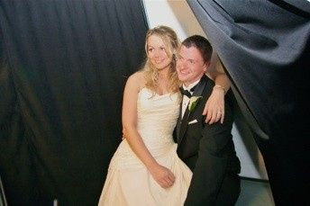 Behind the scenes view of the bride & groom in our photo booth