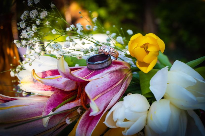 The ring atop vivid florals - Aerial and 360 Weddings
