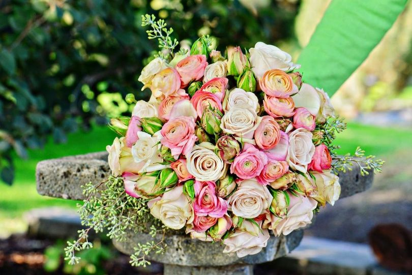Roses and ranunculus with a touch of seeded eucalytpus