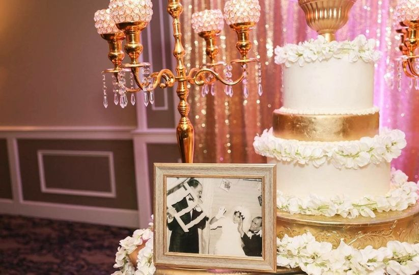 Wedding photograph by the cake