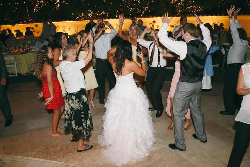 Couple dancing with the guests