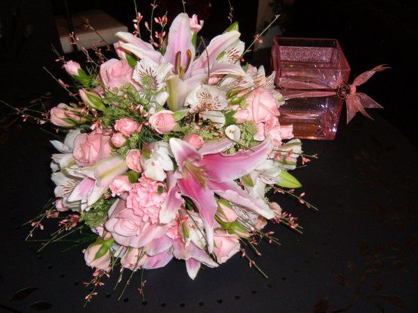 Shades of pink lilies, spray sweetheart roses, pale pink mini carnations and fragrant genestra