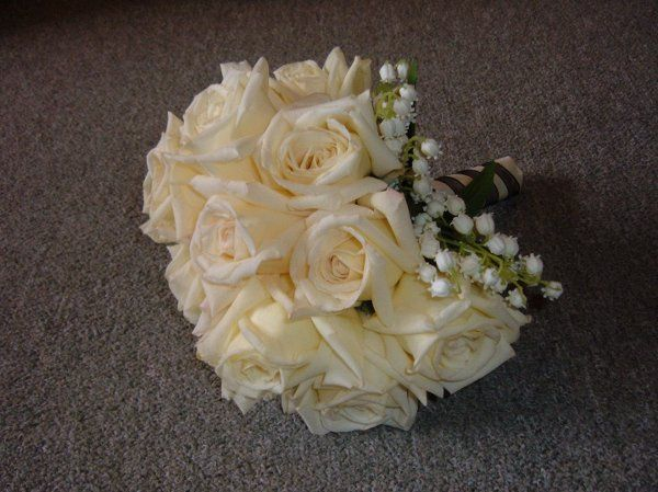 Fragrant classic fresh virginia roses hand tied with (ssshhhhh!) silk lily of the valley!