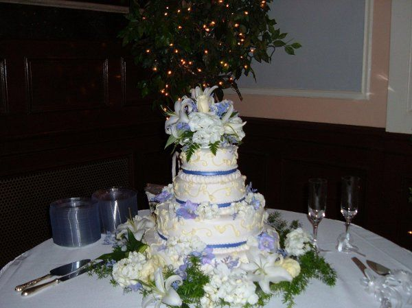 Beautiful cake by Angie Young, owner of A Piece of Cake.  Our fresh flowers compliment the color...
