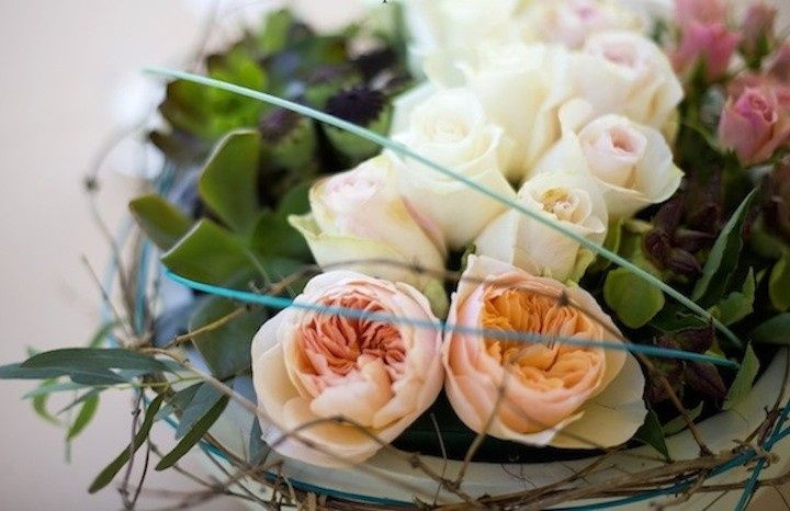 A table centerpiece in garden Roses and Succulents