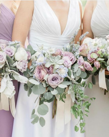 Soft lilacs and grays in these bouquets.