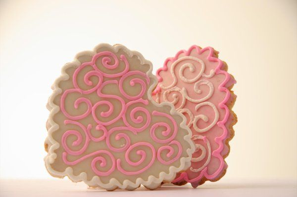 Let this romantic classic heart cookie decorated with elegant swirls be a part of your special...