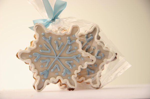 This beautifully decorated ice blue and white snowflake is perfect for any winter wedding event!