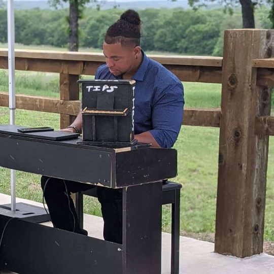 Playing piano at OG Cellers