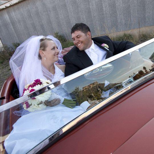 Newlyweds in their car