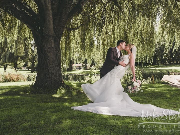 Tmx 09 07 19 Bride Groom Kissing Under Willow 51 1014657 157981581992051 Ypsilanti, Michigan wedding venue