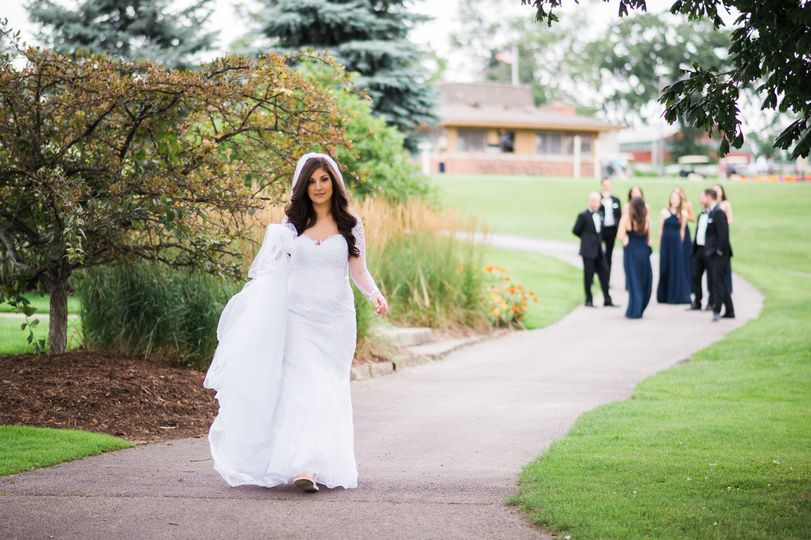 Bride walking down the path