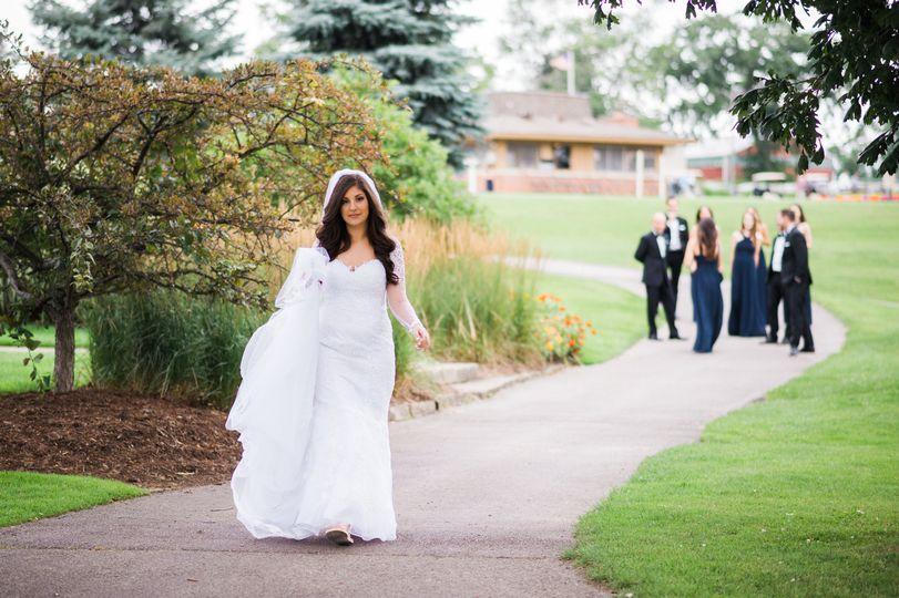 Bride walking down the path