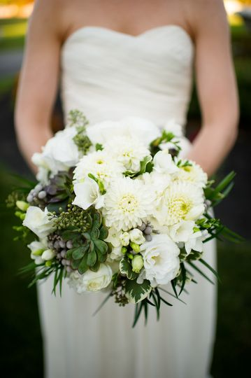White bouquet held by the bride