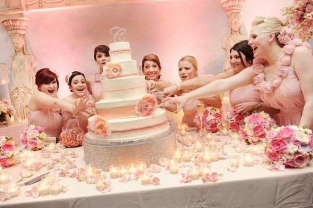 The bridesmaids and the wedding cake