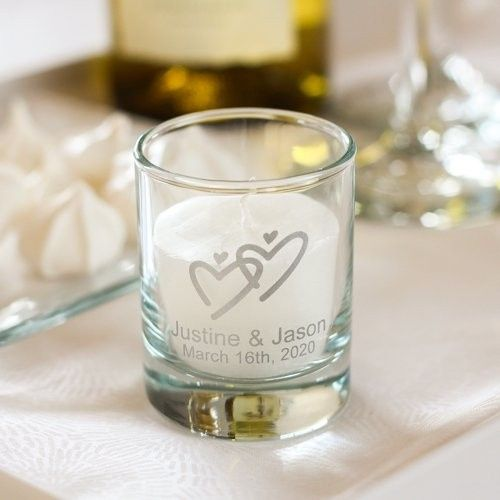 A candle with the couple's names and dates, add a removable tag to tell your guest where to sit!...