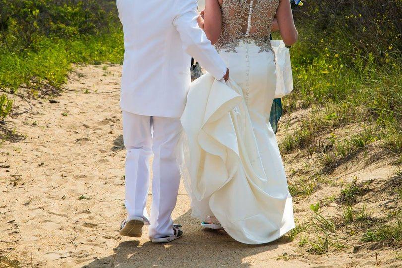 Groom assisting his bride
