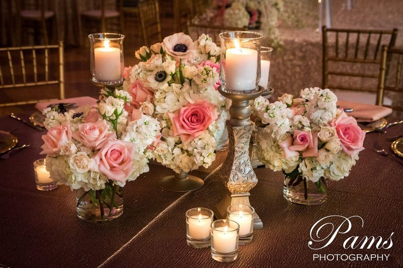 It is a fairy-tale reception filled with Golden Candlesticks, amazing florals and centepieces in a...