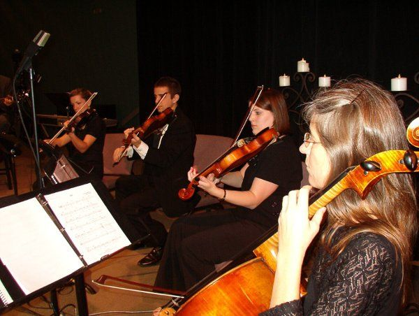 Jacksonville Strings quartet playing an indoor wedding ceremony