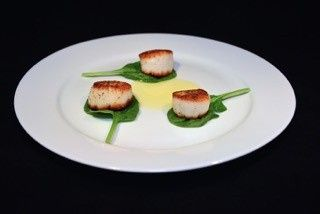 Seared scallop with a lemon butter sauce